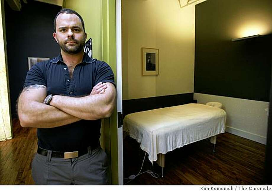 Greg Griffin stands in the hallway outside the massage area at Barber Lounge on Folsom Street in San Francisco, Calif., on Friday, Nov. 14, 2008. Griffin says that outdated bathhouse zoning rules are causing hardships for legitimate massage businesses like his. Photo: Kim Komenich, The Chronicle