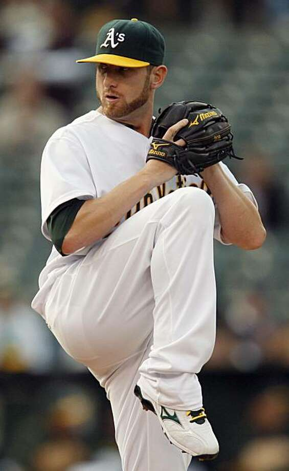 Oakland Athletics pitcher Dallas Braden works against the Cincinnati Reds during the first inning of a baseball game Tuesday, June 22, 2010, in Oakland, Calif. Photo: Ben Margot, AP