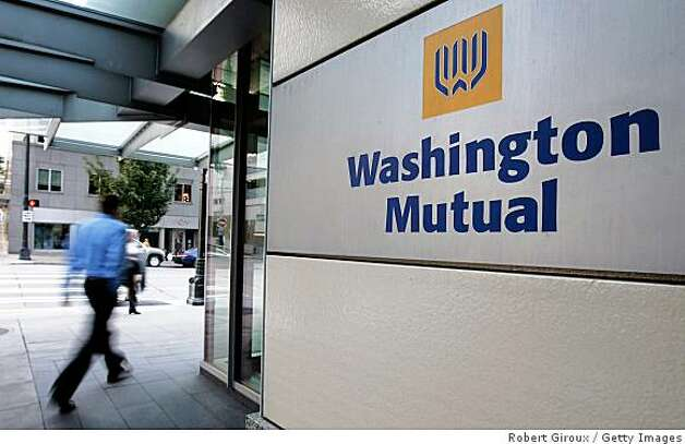 SEATTLE - SEPTEMBER 16: (FILE PHOTO )  People walk past Washington Mutual Inc.'s headquarters September 16, 2008 in Seattle. JPMorgan Chase has acquired the banking operations of Washington Mutual which was seized by US regulators on Thursday night (September 25, 2008) in the biggest bank failure in US history. (Photo by Robert Giroux/Getty Images) Photo: Robert Giroux, Getty Images