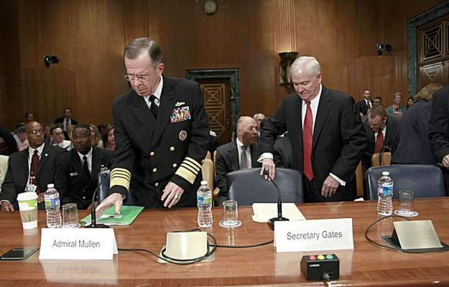 Joint Chiefs Chairman Adm. Mike Mullen, left, and Defense Secretary Robert Gates, take their seats on Capitol Hill in Washington, Wednesday, June 16, 2010, prior to testifying before the Senate Appropriations Committee hearing on the Defense Department'sfiscal 2011 budget. Photo: Pablo Martinez Monsivais, AP