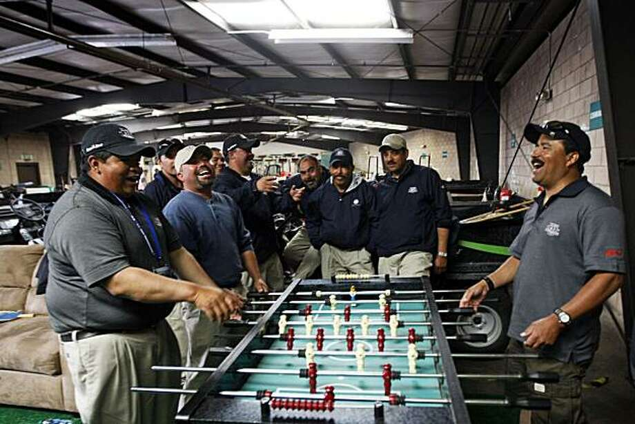 Greens-Keepers relax during their break in the maintenance yard at Pebble Beach Golf Links with a game of foosball. Monday June 14, 2010. The team of 35 staffers has more than doubled with the addition of 40 volunteers to ready the course for the US Open that starts Thursday. Photo: Lance Iversen, The Chronicle