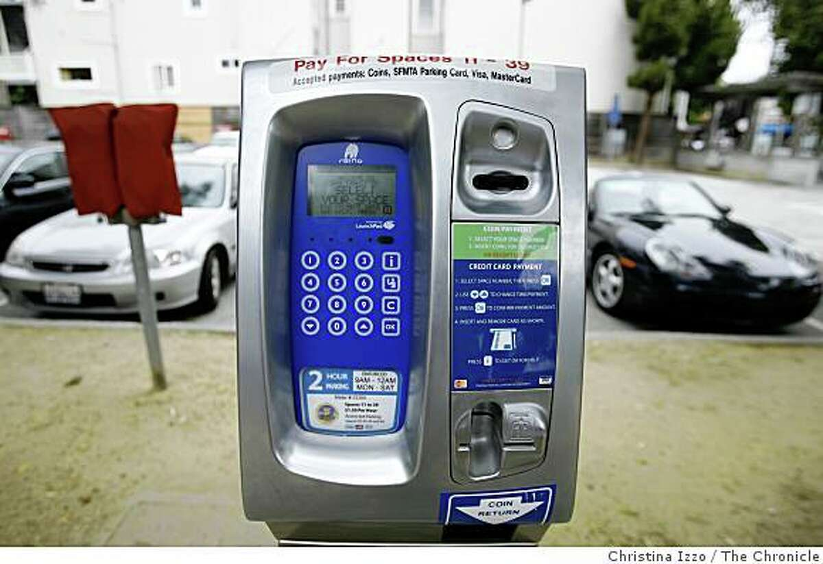 A new parking meter is being tested in a city-owned lot on California street on Wednesday, July 16, 2008, San Francisco, Calif. San Francisco is testing a new parking program at a city-owned lot on California Street in which individual meters have been replaced with pay stations on Wednesday, July 16,2008, San Francisco, Calif. Photo by Christina Izzo / The Chronicle