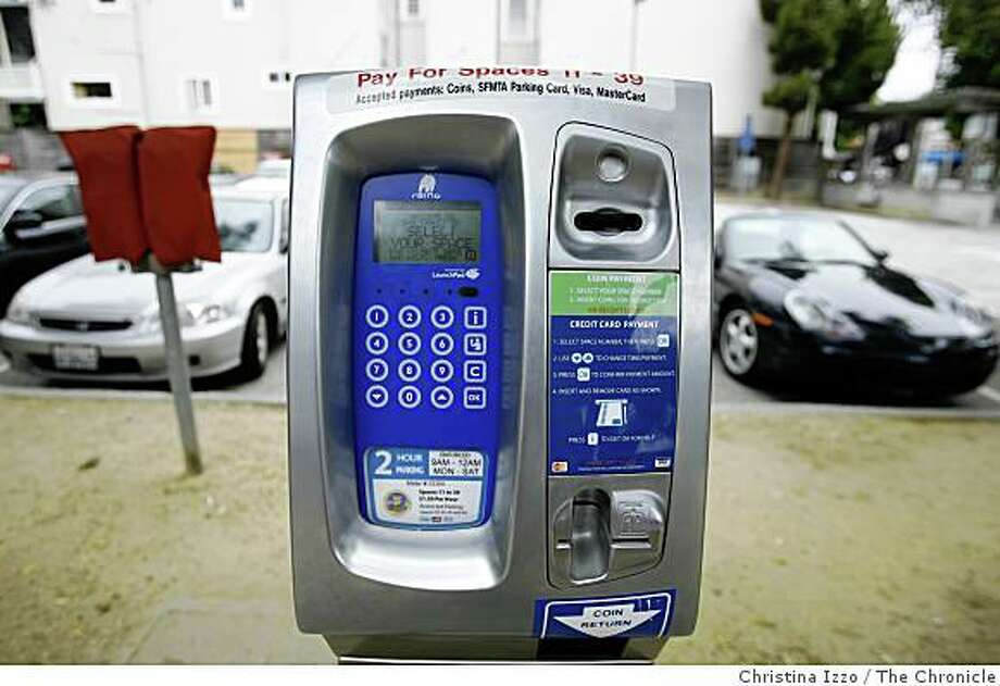 A new parking meter is being tested in a city-owned lot on California street on Wednesday, July 16, 2008, San Francisco, Calif. San Francisco is testing a new parking program at a city-owned lot on California Street in which individual meters have been replaced with pay stations on Wednesday, July 16,2008, San Francisco, Calif. Photo by Christina Izzo / The Chronicle Photo: Christina Izzo, The Chronicle