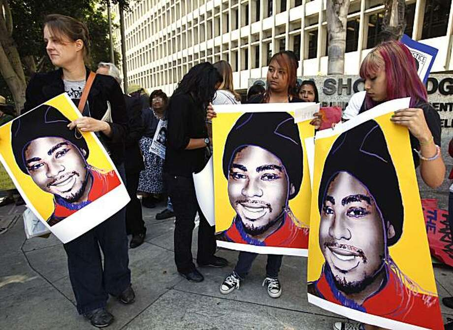 Supporters hold posters of Oscar Grant during a protest in Los Angeles on Monday. Protesters have demonstrated repeatedly outside the L.A. courthouse where former BART officer Johannes Mehserle is being tried. Photo: Nick Ut, AP