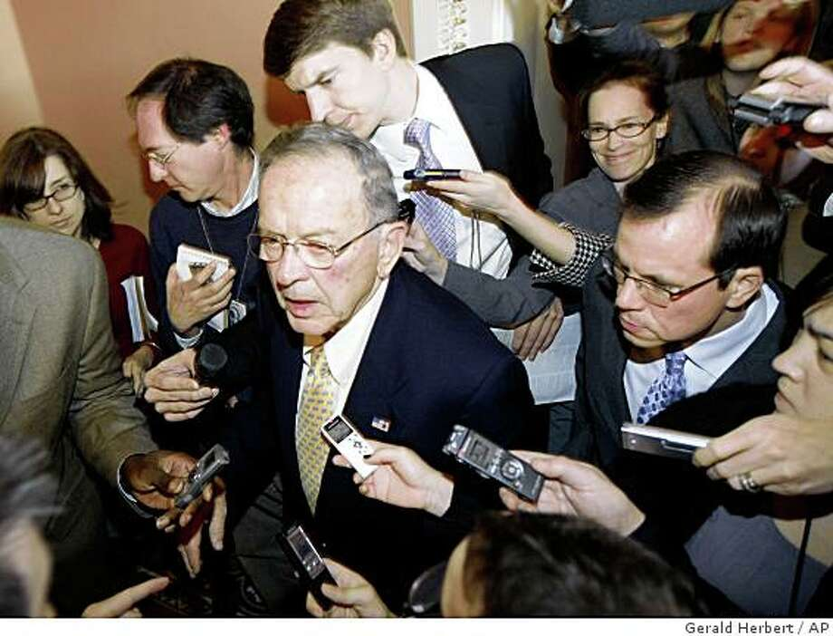 Sen. Ted Stevens, R-Alaska, is pursued by members of the media on Capitol Hill in Washington, Tuesday, Nov. 18, 2008, after attending a Republican Caucus . (AP Photo/Gerald Herbert) Photo: Gerald Herbert, AP