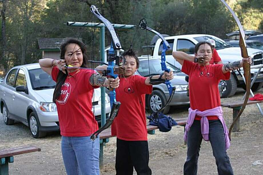 Girls learn to shoot with instructors Greg Tobler and Stacie Kierstead of the Diablo Bowmen Archery Club. Photo: Diane Montanez
