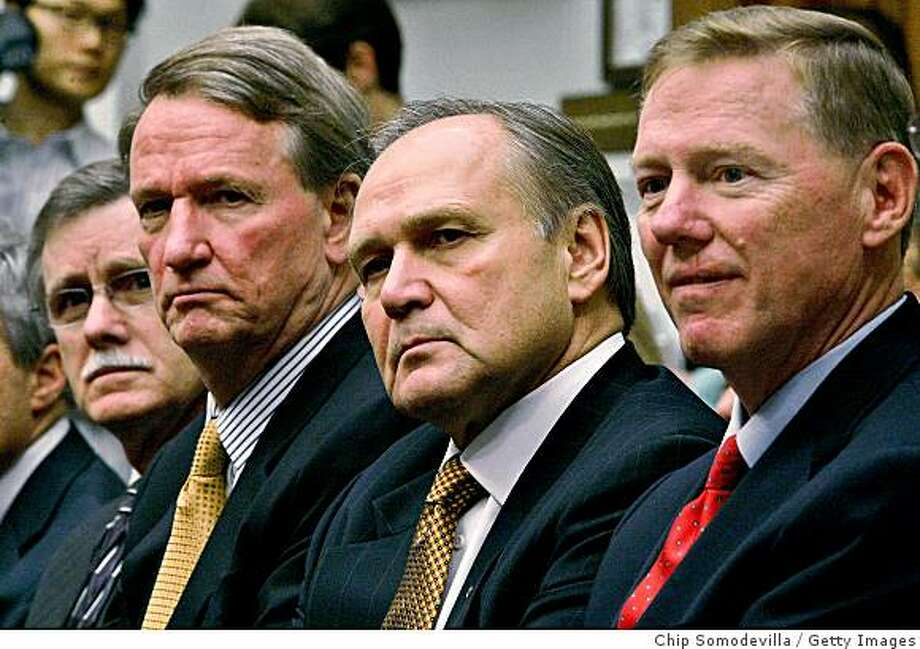 """WASHINGTON - NOVEMBER 19:  (L-R) UAW President Ron Gettelfinger, Chairman and CEO of General Motors Richard Wagoner, Chairman and CEO of Chrysler LLC Robert Nardelli and President and CEO of the Ford Motor Company Alan Mulally prepare to testify before the House Financial Services Committee on Capitol Hill November 19, 2008 in Washington, DC. The leaders of the """"Big Three"""" Detroit automakers and the head of the union that represents their workers were on Capitol Hill to ask lawmakers for $25 billion to help them wheather the recent financial crisis and """"retool"""" for the future.  (Photo by Chip Somodevilla/Getty Images) Photo: Chip Somodevilla, Getty Images"""