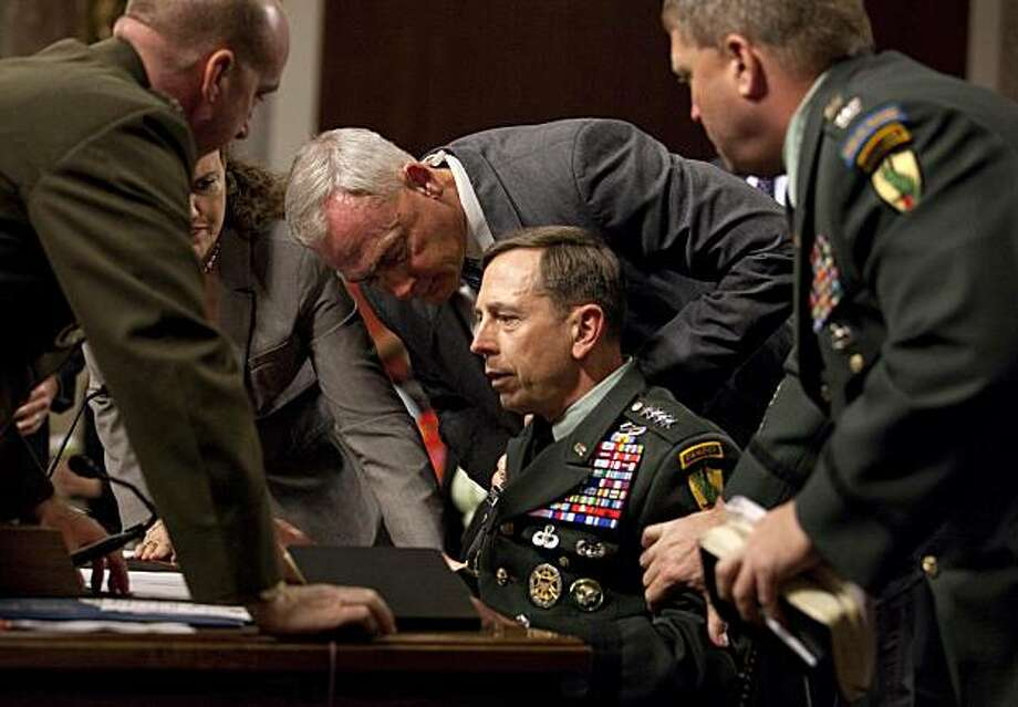 U.S. Central Commander Gen. David Petraeus is surrounded by staff after appearing to collapse on Capitol Hill in Washington, Tuesday, June 15, 2010, while testifing before the Senate Armed Services Committee. Photo: Evan Vucci, Associated Press