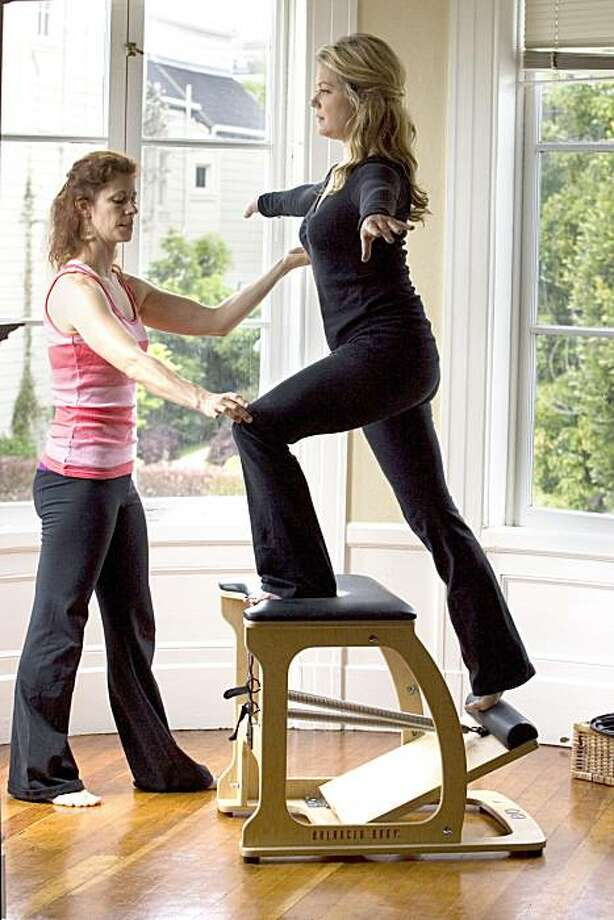 """Kendra Kassebaum, right, who plays the good witch """"Glinda"""" in Wicked, starts her performance days in private pilates training with Helena Talman in San Francisco, Calif. on Sunday, May 16, 2010. Kat Wade / Special to the Chronicle Photo: Kat Wade, Special To The Chronicle"""