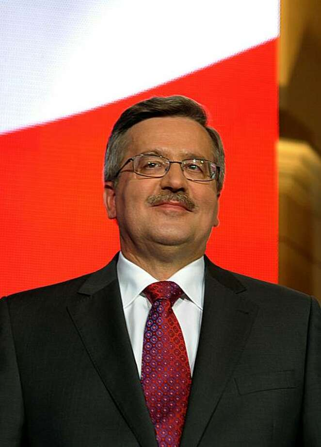 Parliament Speaker, acting president and presidential candidate Bronislaw Komorowski reacts in Warsaw after acknowledging exit polls for the early presidential elections in Poland on June 20, 2010. Photo: Janek Skarzynski, AFP/Getty Images