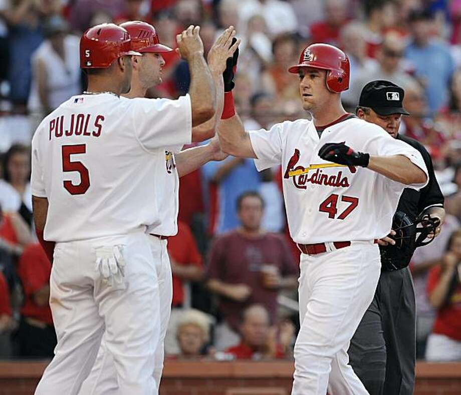St. Louis Cardinals' Ryan Ludwick (47) is congratulated by teammates Albert Pujols (5) and Matt Holliday after his three-run home run against the Seattle Mariners in the first inning in a baseball game Monday, June 14, 2010 in St. Louis. Photo: Bill Boyce, AP