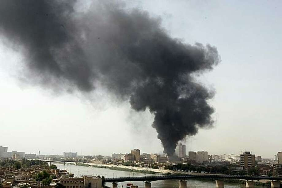Smoke billows from the scene of one of five explosions that rocked the Iraqi capital Baghdad on June 13, 2010 within minutes of each other, killing at least two people, according to an interior ministry official. Photo: Sabah Arar, AFP/Getty Images