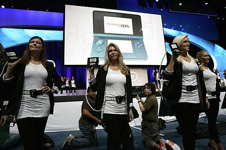 """Models walk on stage with Nintendo Co.'s new 3DS game at the Electronic Entertainment Expo (E3) in Los Angeles, California, U.S., on Tuesday, June 15, 2010. Nintendo unveiled a 3-D portable game player today, betting the technology that helped """"Avatar"""" break box-office records will also be popular on screens small enough to fit in one's pocket. Photographer: Jonathan Alcorn/Bloomberg Photo: Jonathan Alcorn, Bloomberg"""