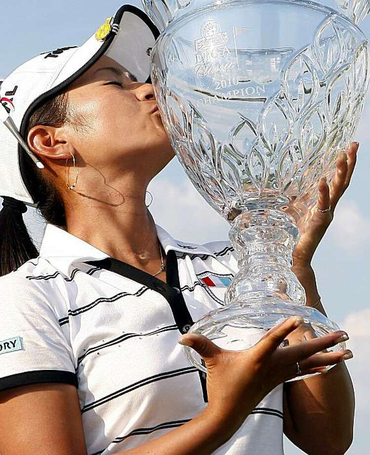 Ai Miyazato of Japan kisses the trophy after winning the ShopRite LPGA Classic golf tournament Sunday, June 20, 2010, in Galloway, N.J. Miyazato shot a 16-under 197 for the tournament win. Photo: Mel Evans, AP