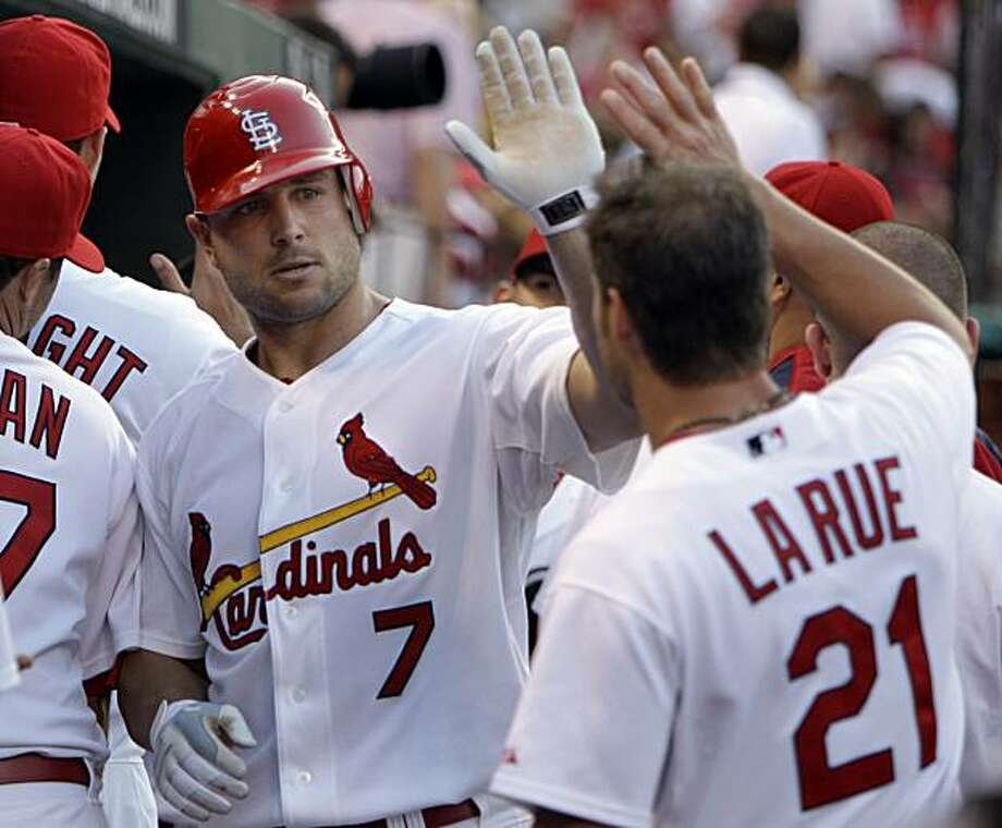 St. Louis Cardinals' Matt Holliday, left, is congratulated by teammate Jason LaRue after hitting a two-run home run during the first inning of a baseball game against the Oakland Athletics, Friday, June 18, 2010, in St. Louis. The Cardinals defeated the Athletics 6-4. Photo: Jeff Roberson, AP