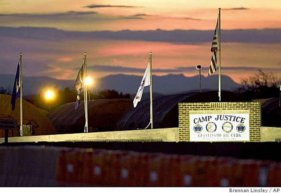 **FILE** In this June 4, 2008 file photo, the sun sets over Camp Justice and its adjacent tent city, the legal complex of the U.S. Military Commissions, at Guantanamo Bay U.S. Naval Base, in Cuba.  (AP Photo/Brennan Linsley, File) Photo: Brennan Linsley, AP