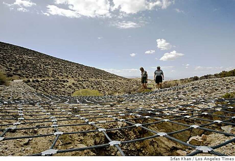 MINES: Linda Greene, left, and Linda Manning, employees at Death Valley National Park, walk near a mesh-covered mine. The park has more abandoned mines than any other in the nation. Illustrates MINES (category a) by David Kelly (c) 2008, Los Angeles Times. Moved Monday, Nov. 10, 2008. (MUST CREDIT: Los Angeles Times photo by Irfan Khan.) Linda Greene, left, and Linda Manning, employees at Death Valley National Park, walk near a mesh-covered mine. The park has more abandoned mines than any other in the nation. Illustrates MINES (category a) by David Kelly (c) 2008, Los Angeles Times. Moved Monday, Nov. 10, 2008. (MUST CREDIT: Los Angeles Times photo by Irfan Khan.) Photo: Irfan Khan, Los Angeles Times