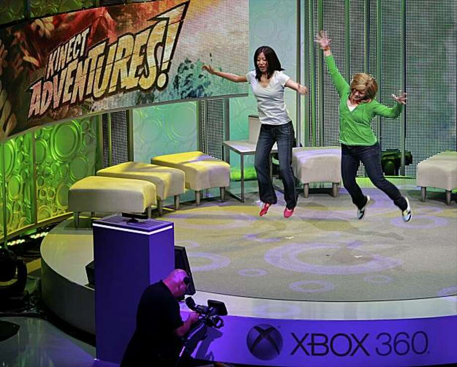 Microsoft live demonstration of its new Kinect video game interactivity technology during the 2010 Xbox 360 media briefing at the Wiltern Theater on Monday, June 14, 2010, in Los Angeles. Microsoft's Kinect's voice and gesture feature once known as Project Natal, recognizes users' gestures and voices, so they can control on-screen avatars in racing, action and sports games just by moving your body. Photo: Damian Dovarganes, AP