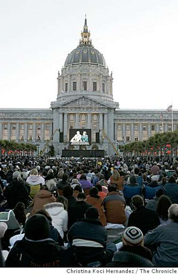 """An outdoor audience, at San Francisco's Civic Center Plaza, enjoys a simulcast broadcast of San Francisco Opera's new production of Madama (cq) Butterfly. In this first new experiment to shake up and generate new audiences, the San Francisco Opera - under new general manager David Gockley- simulcasts the world premiere of this production of """"Madama(cq) Butterfly"""" on a single, 16-foot x 24-foot LED screen. Photo: Christina Koci Hernandez, The Chronicle"""