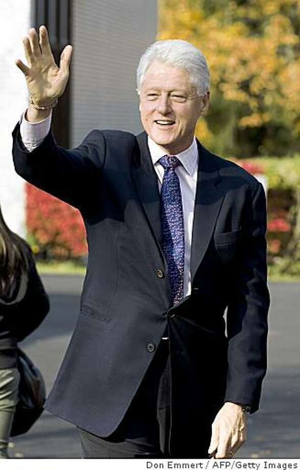 Former US President Bill Clinton waves as he exits his polling station after casting his vote in the 2008 Presidential Election November 4, 2008 in Chappaqua, NY. Clinton said he voted for Senator Barrack Obama. AFP PHOTO/DON EMMERT (Photo credit should read DON EMMERT/AFP/Getty Images) Photo: Don Emmert, AFP/Getty Images