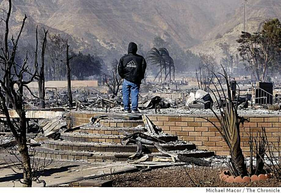 Juan Martinez surveys the Oak Ridge trailer park where his daughter lives in Sylmar, Calif., on Saturday  Nov. 15, 2008,  after a fast moving fire ripped through the complex destroying most of the homes in the park. He said he couldn't recognize his daughter's trailer in all of the rubble. Photo: Michael Macor, The Chronicle