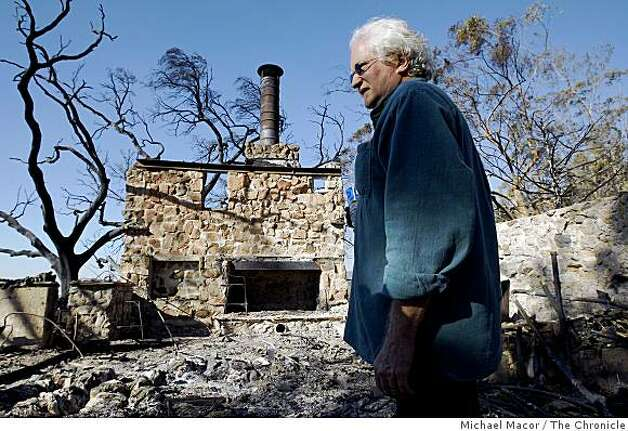 Michael Collins surveys the remains of his home on Mountain Dr. in Montecito, Calif., on Saturday,  Nov. 15, 2008, after a fast moving fire moved through the neighborhood destroying over 100 homes on Thursday night. Photo: Michael Macor, The Chronicle