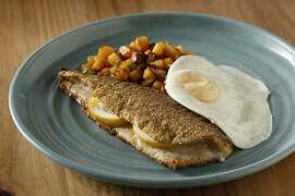Pan-Fried Trout with Polenta-Spice Crust served with Fiery Smoky Potato Hash in San Francisco, Calif., on June 16, 2010. Food styled by Britt Billmaier.