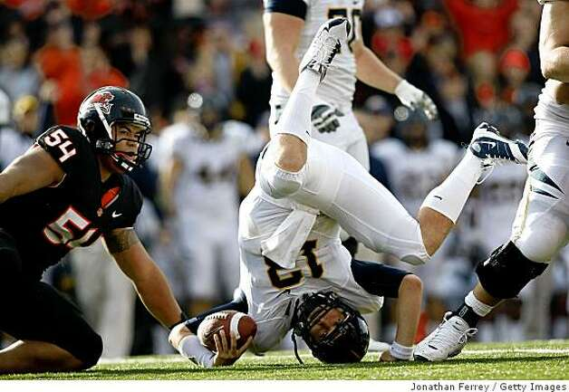 CORVALLIS, OR - NOVEMBER 15:  Quarterback Kevin Riley #13 of the California Golden Bears rolls on heis head after being sacked by Stephen Paea #54 the Oregon State Beavers at Reser Stadium on November 15, 2008 in Corvalis, Oregon.  (Photo by Jonathan Ferrey/Getty Images) Photo: Jonathan Ferrey, Getty Images