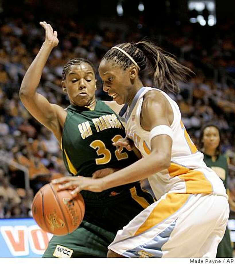 Tennessee's Glory Johnson (25) drives against San Francisco's Vania Singleterry (32) during the second half of a NCAA college basketball game Saturday, Nov. 15, 2008 in Knoxville, Tenn. Tennessee won 68-39.(AP Photo/Wade Payne) Photo: Wade Payne, AP