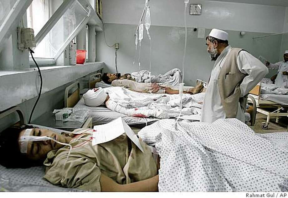 Afghan victims receive treatment at a hospital after they were injured in a suicide attack in Batti Kot district of Nangarhar province, Afghanistan, Thursday, Nov. 13, 2008. A suicide car bomber struck a U.S. military convoy passing through a crowded market in eastern Afghanistan Thursday, killing at least 20 civilians and a U.S. soldier and wounding an additional 74 civilians, officials said. (AP Photo/Rahmat Gul) Photo: Rahmat Gul, AP