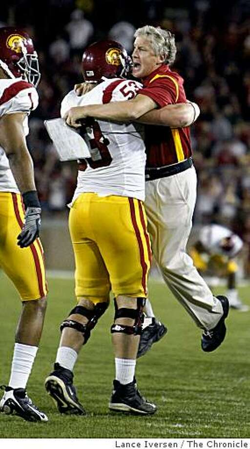 USC Offensive Guard Jeff Byers celebrates with head coach Pete Carroll after USC scored their second touchdown of the second half. USC defeated Stanford 45-23 in Stanford, Calif on November 15, 2008. Photo: Lance Iversen, The Chronicle