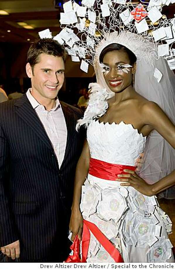 """Project Inform held a condom fashion show in Octoberto benefit HIV/AIDS advocacy.""""Project Runway"""" competitor Jack Mackenroth wth a model in his condom wedding dress Photo: Drew Altizer Drew Altizer, Special To The Chronicle"""