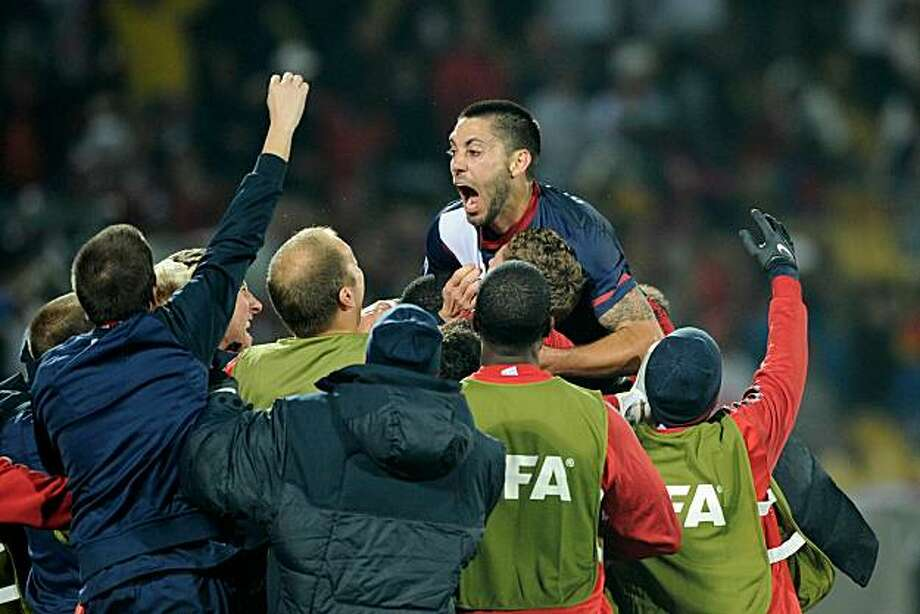 RUSTENBURG, SOUTH AFRICA - JUNE 12:  Clint Dempsey of the United States celebrates his goal with teammates during the 2010 FIFA World Cup South Africa Group C match between England and USA at the Royal Bafokeng Stadium on June 12, 2010 in Rustenburg, South Africa. Photo: Kevork Djansezian, Getty Images