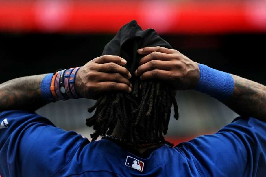 WASHINGTON, DC - SEPTEMBER 2: Jose Reyes #7 of the New York Mets fixes his hair during batting practice before taking on the Washington Nationals at Nationals Park on September 2, 2011 in Washington, DC. (Photo by Patrick Smith/Getty Images) (Getty Images)