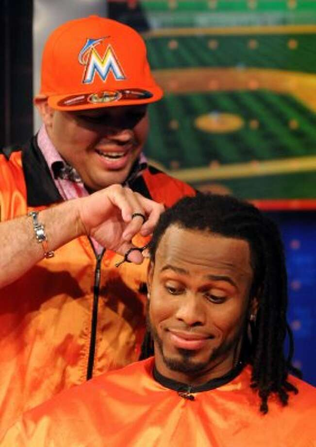 In this photo released by MLB Network, Miami Marlins shortstop Jose Reyes gets a haircut from Jordan of  Jordan's Barber Shop in the Bronx, N.Y.,  at the MLB Network in Secaucus, N.J., Friday, Feb. 3, 2012. Network spokeswoman Lorraine Fisher said the trim will benefit the Make-A-Wish Foundation of Southern Florida, which planned to auction the hair on eBay. (AP Photo/Retna, George Napolitano, via MLB Network) MANDATORY CREDIT (AP)