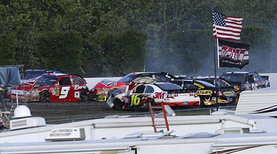 The cars of Kasey Kahne (9), Jeff Gordon, Greg Biffle (16) and others collide during the final lap of the NASCAR Sprint Cup Series auto race Sunday, June 6, 2010, in Long Pond, Pa. Photo: Russ Hamilton Jr., AP