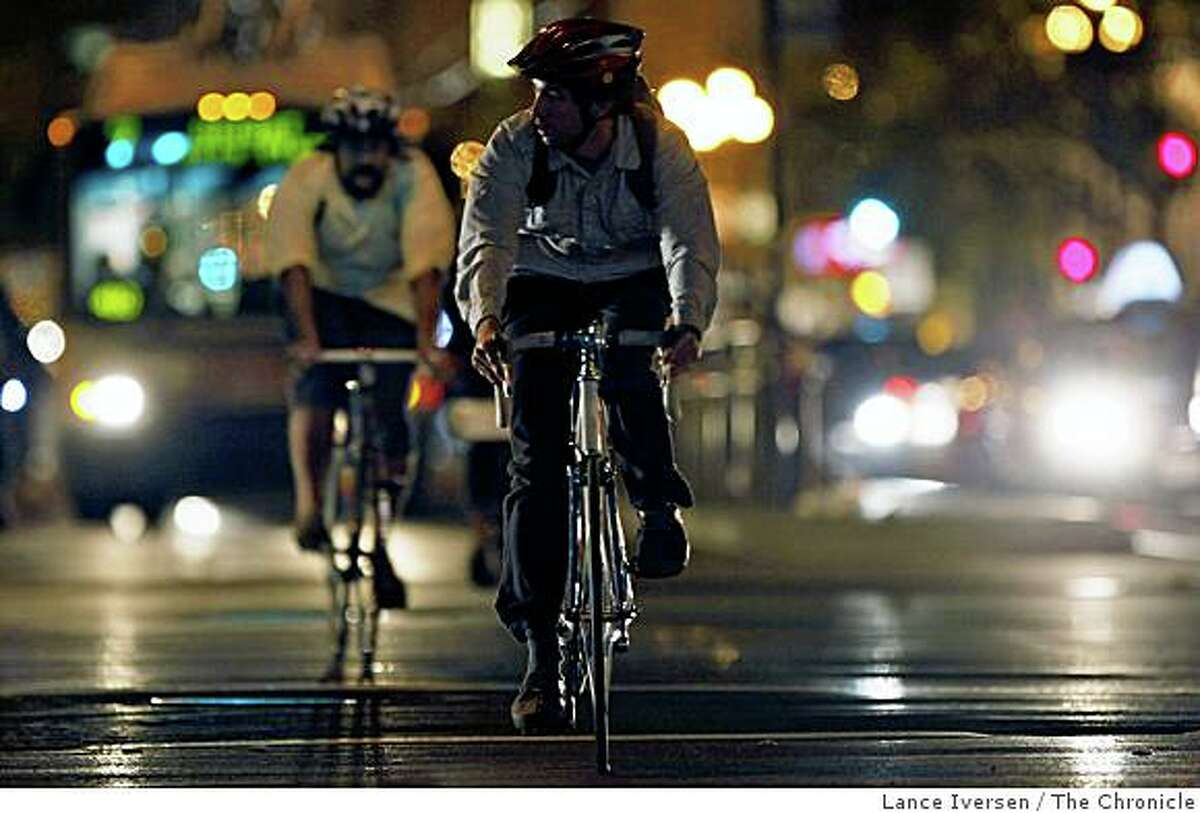 Cyclists peddle up Market Street at Gough Street in San Francisco on Thursday, Nov. 13, 2008.
