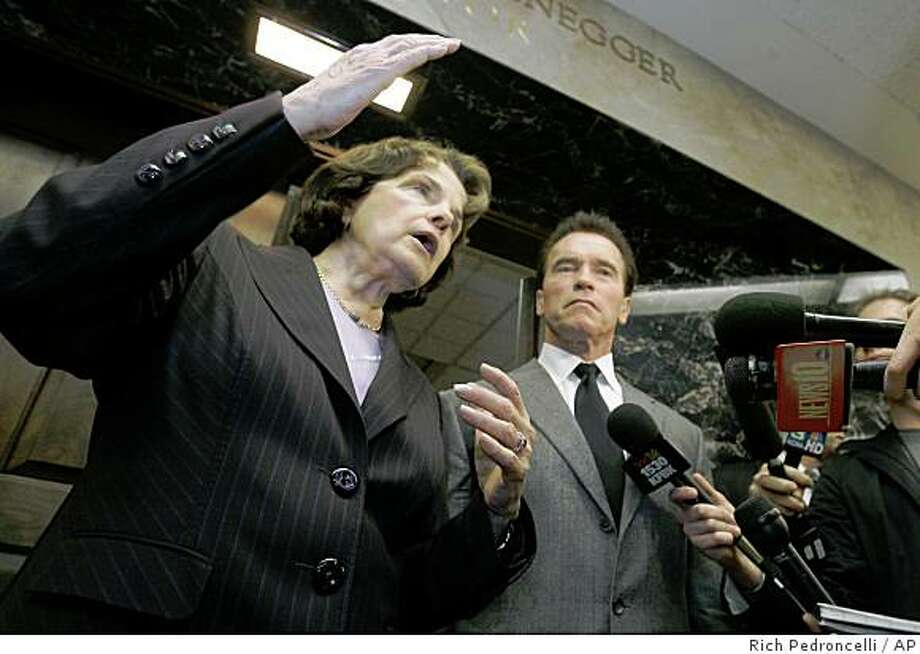 U.S. Senator Dianne Feinstein answers a reporters question concerning a water bond she said she would help Gov. Arnold Schwarzenegger   come up with, during a news conference at the Capitol, in Sacramento, Calif., Thursday,  Feb. 21, 2008.  Feinstein met with Schwarzenegger, and legislative leaders to help restart talks in an effort to come with comprehensive water plan for California.(AP Photo/Rich Pedroncelli) Photo: Rich Pedroncelli, AP