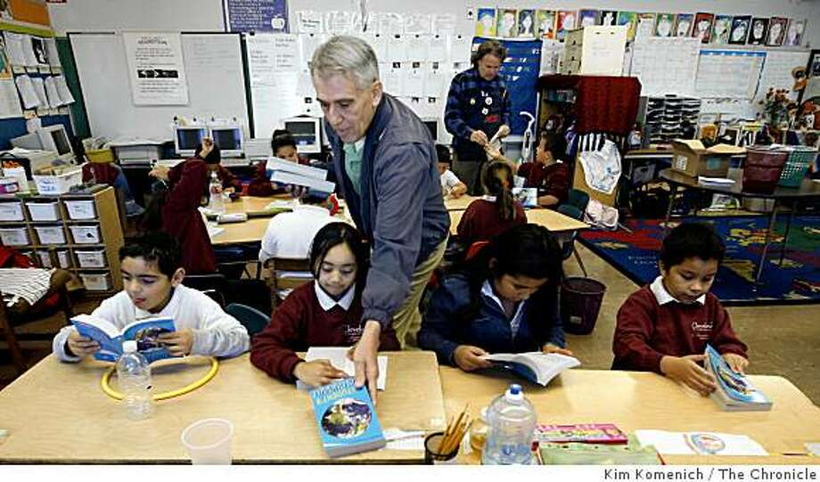 Retired California Highway Patrol Lieutenant John Weidinger, 67, hands out free dictionaries to students Jorge Jimenez, 8, left,  Maria Flores, 8, Yamilet Escobar, 8 and Christian Linares, 8, in John Morgan's third grade class at Cleveland Elementary School in San Francisco, Calif., on Thursday, Nov. 13, 2008. Every third grader in San Francisco will receive a free dictionary  courtesy of  the California Dictionary Project. Photo: Kim Komenich, The Chronicle