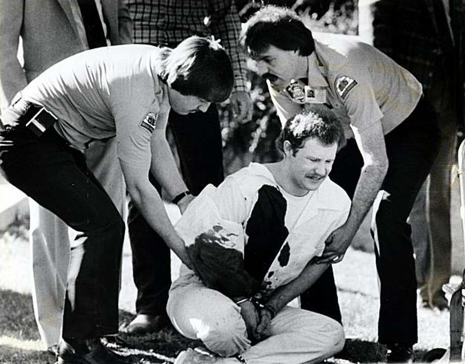 FILE - In this April 1985 picture, Ronnie Lee Gardner is restrained on the lawn at the Metropolitan Hall of Justice, in Salt Lake City after the courthouse shooting death of attorney Michael Burdell during Gardner's failed escape attempt. Ronnie Lee Gardner is scheduled to be executed by firing squad at midnight on June 18, 2010. (AP Photo/Deseret News, O. Wallace Kasteler) SALT LAKE TRIBUNE OUT; PROVO DAILY HERALD OUT; MAGS OUT; NO SALES Photo: O. Wallace Kasteler, AP