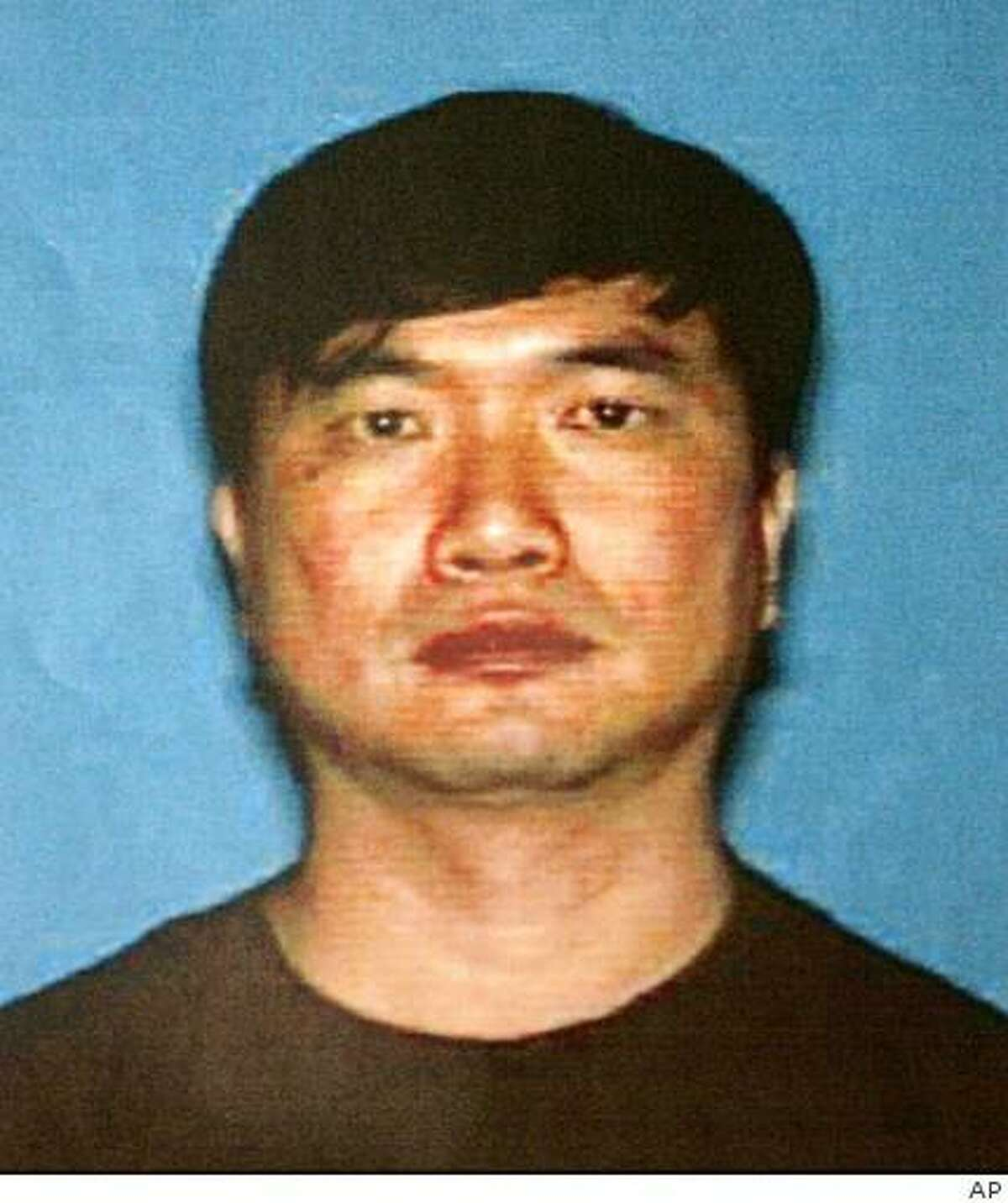 In this undated photo released by the Santa Clara Police via San Jose Mercury News, Jing Wu is seen. Police say Wu, a laid-off worker, returned to his former office in Northern California and fatally shot three people. (AP Photo/Santa Clara Police Department via San Jose Mercury News) ** MAGS OUT, NO SALES **