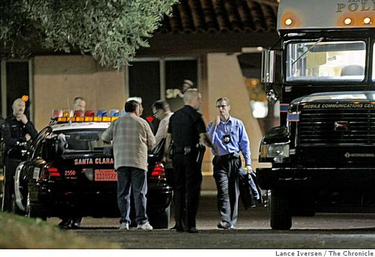 A Santa Clara Police officers work on the triple homicide from their command center in a office complex off Scott Blvd Friday November 14, 2008