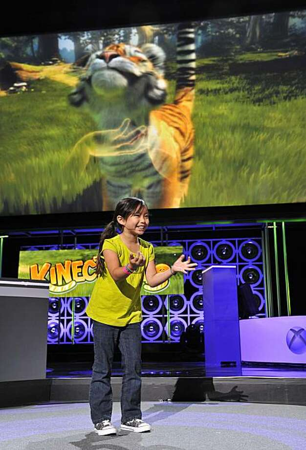 "**COMMERCIAL IMAGE** In this photograph taken by AP Images for Xbox, Xbox 360 demonstrates ""Kinectimals,"" a completely controller-free experience that allows animal lovers of all ages to get up close and personal with some of the world's most exotic creatures at Microsoft's E3 Media Briefing  on Monday, June 14, 2010, in Los Angeles. (Vince Bucci/AP Images for Xbox) Photo: Vince Bucci, AP Images For Xbox"