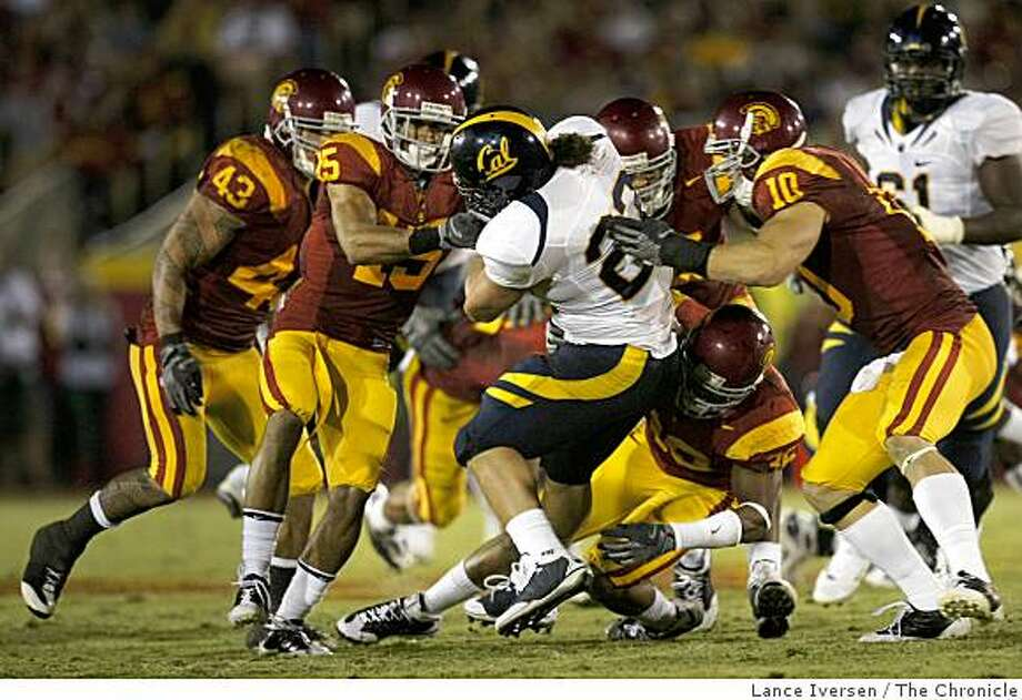 CAL's Will Ta'ufo'ou(23) is swarmed by the USC defense in the fourth quarter as USC beat Cal 17-3 in Los Angeles, Calif., on Saturday, November 8, 2008. Photo: Lance Iversen, The Chronicle