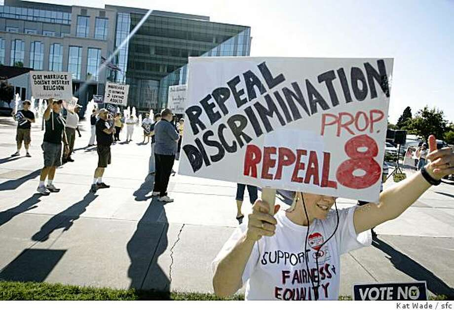 """Linda Waite waves a signs reading """"repeal Prop. 8, when she joined approximately 75 people in front of the Solano County Courthouse  to join a nationwide protest against Proposition 8 in Fairfield, Calif. on Saturday, November 15, 2008. Photo: Kat Wade, Sfc"""