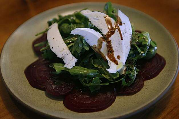A beet salad with arugula and ricotta is served at Osteria Stellina in Point Reyes Station, Calif., on Friday, June 11, 2010. Stellina's chef/owner Christian Caiazzo also owns and operates the coffee bar at Toby's Feed Barn across the street. Photo: Paul Chinn, The Chronicle