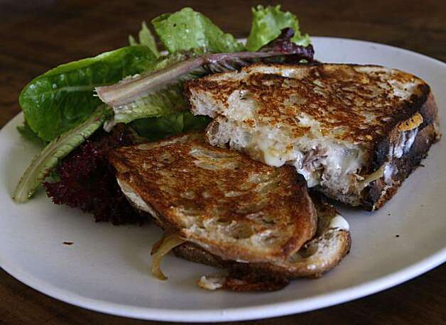 A grilled cheese sandwich is served with mixed organic greens at Osteria Stellina in Point Reyes Station, Calif., on Friday, June 11, 2010. Stellina's chef/owner Christian Caiazzo also owns and operates the coffee bar at Toby's Feed Barn across the street. Photo: Paul Chinn, The Chronicle