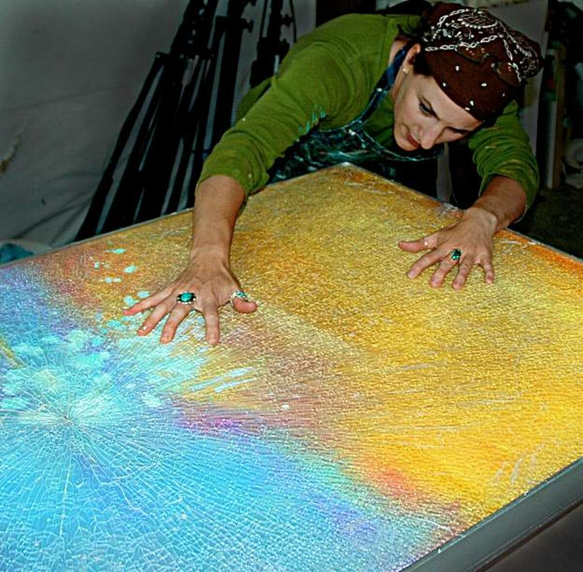 eglomise artist Cassandria Blackmore uses a shattered-glass technique to create abstract paintings.