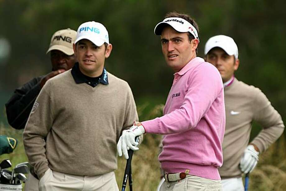 PEBBLE BEACH, CA - JUNE 15:  (L-R) Louis Oosthuizen of South Africa and Edoardo Molinari of Italy look on during a practice round prior to the start of the 110th U.S. Open at Pebble Beach Golf Links on June 15, 2010 in Pebble Beach, California. Photo: Scott Halleran, Getty Images