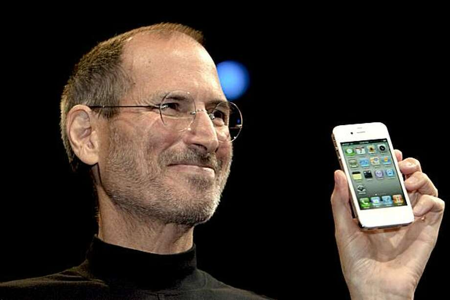Steve Jobs, chief executive officer of Apple Inc., unveils the iPhone 4 during his keynote address at the Apple Worldwide Developers Conference (WWDC) in San Francisco, California, U.S., on Monday, June 7, 2010. Jobs introduced the redesigned iPhone 4 today, delivering a 24 percent thinner body and 100 new features as mobile competitors including Google Inc. work to usurp the smartphone's popularity. Photographer: David Paul Morris/Bloomberg *** Local Caption *** Steve Jobs Photo: David Paul Morris, Bloomberg